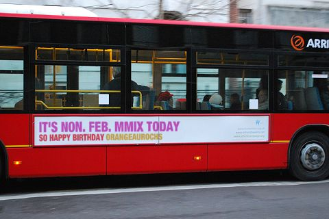 Advert on London bus: IT'S NON. FEB. MMIX TODAY, SO HAPPY BIRTHDAY ORANGEAUROCHS